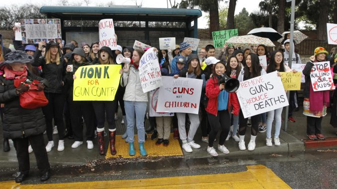 Hundreds of Gunn High School students and parents demonstrate for gun control across the street of the main entrance of Gunn this morning (Feb. 26). Photo by Paul Sakuma of Paul Sakuma Photography, www.PaulSakuma.com