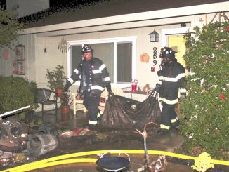 Firefighters remove damaged items from a house at 298 Beresford Ave. in unincorporated Redwood City. Photo provided by the Menlo Park Fire Protection District.