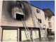 A two-alarm fire struck this apartment house at 2411 Middlefield Road today (May 19). Photo from Redwood City Fire Department via Twitter.