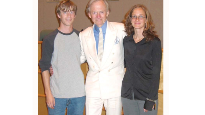 Tom Wolfe poses with Jenny Davis, a former events coordinator at Kepler's Books, and another Kepler's employee at a 2004 bookstore event. Photo courtesy of Kepler's CEO Praveen Madan.