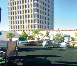 Hotel President tenants use this rooftop patio. In the background is the 15-story 525 University office tower.