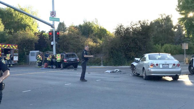 Palo Alto police and firefighter-paramedics responded to a two-car crash at the intersection of Middlefield Road and Oregon Expressway at about 7:45 p.m. tonight (June 13). Medics attended to one person in the SUV that crashed into the stoplight pole, but there was no immediate information on the extent of injuries. Post photo.