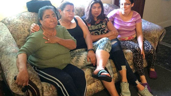 From left, tenants Teresa Rivas, Eisabel Coronel, Lilian Flores and Sandra Zamora sit in Zamora's 430-square-foot apartment at 505 Pierce Road in Menlo Park's Belle Haven neighborhood, located about a mile away from Facebook's expansion on Constitution Drive. Post photo by Emily Mibach.