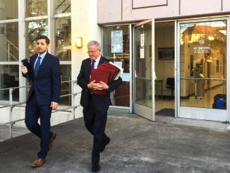 Michael Airo, left, a former Ohlone Elementary School teacher accused of molesting his ex-girlfriend's daughter for three years, leaves the Palo Alto courthouse yesterday with his defense attorney, Michael Armstrong. Post photo by Allison Levitsky.