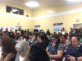 The Ravenswood City School District board room had an overflow crowd for Thursday night's meeting. Post photo by Emily Mibach.
