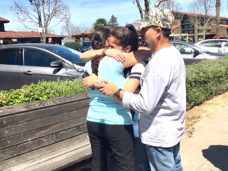 Palo Alto High School freshman Perla del Rio hugs her parents, Jose and Lupe del Rio, after the lockdown ended yesterday. Post photo by Allison Levitsky.