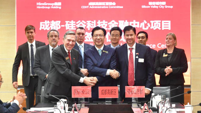 Chinese media has circulated this photo of mid-Peninsula officials at a signing ceremony in Chengdu, China. Local officials in the shot include, Mountain View Mayor Lenny Siegel, second from left, and Menlo Park City Councilwoman Kirsten Keith, far right. In front at right is former Mountain View councilman Mike Kasperzak.