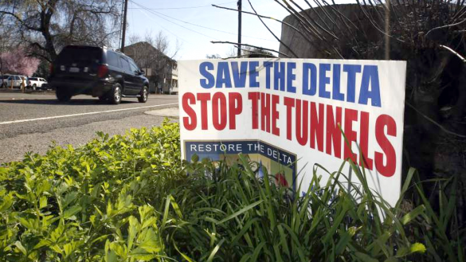 In this Feb. 23, 2016, file photo, a sign opposing a proposed tunnel plan to ship water through the Sacramento-San Joaquin Delta to Southern California is displayed near Freeport, Calif. AP photo.