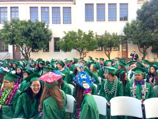 Students await the presentation of their diplomas at Palo Alto High School. Post photo by Allison Levitsky.