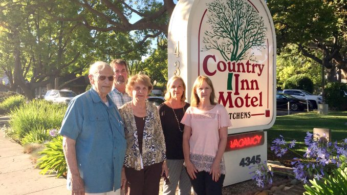 Linda Maher, second from right, stands with her uncle Jim Cesano, mother Rena Gretz and siblings Jim Gretz and Laurie Tinker. The family runs the Country Inn Motel, one of the Palo Alto motels sued by disability access litigant Scott Johnson this year. Post photo by Allison Levitsky.