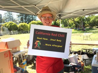 David Chase holds up a sign for the team California Red — the first place winner at the 37th annual Palo Alto Chili Cook-Off. Chase and his chili partner, Robert McDonald, served up over 30 gallons of chili. Post photo by Emily Mibach.