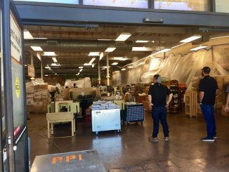 Workers clean up Sprouts Farmers Market in Mountain View following a fire on Friday. Post photo by Allison Levitsky.