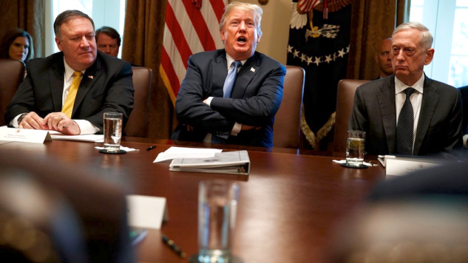 Secretary of State Mike Pompeo, left, and Secretary of Defense Jim Mattis, right, listen as President Trump speaks during a cabinet meeting at the White House on June 21, 2018. AP photo.