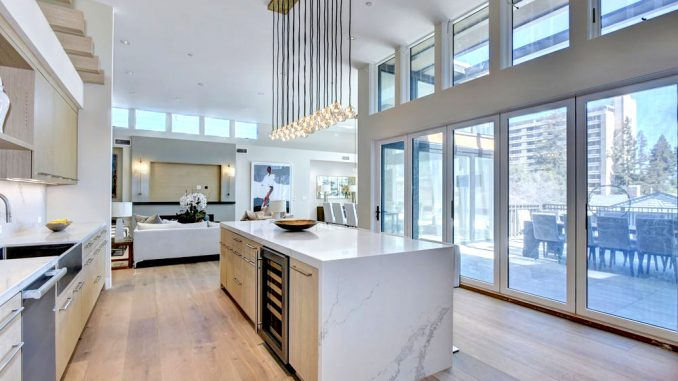 The kitchen in the $35,000-a-month penthouse at 430 Forest Ave. in Palo Alto. The Marc apartment building, where penthouses go for $9,000 to $16,000 a month, can be seen from the window.