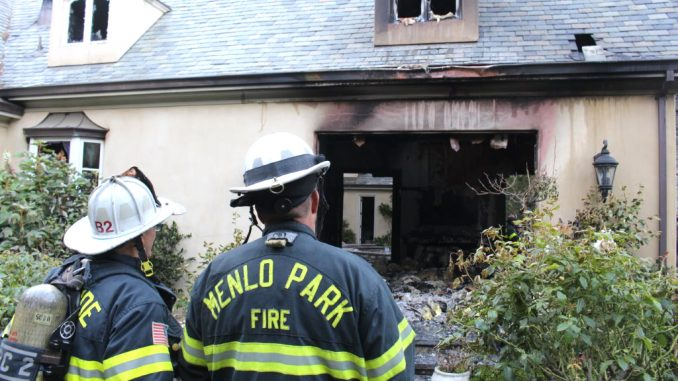 Firefighters look at the damage to a home at 11 Robert S Drive in Menlo Park. Photo courtesy of the Menlo Park Fire Protection District.