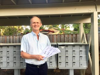 Steve Chandler holds the three ballots he got in the mail from Santa Clara County. Post photo by Allison Levitsky.