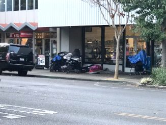 Downtown Menlo Park merchant Kerry Hoctor provided this photo of the belongings of a homeless woman who camps outside his store.