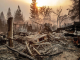 sits among the debris of a burned home as the Camp Fire tears through Paradise on Thursday. AP photo.