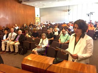 Stanford Associate Vice Chancellor Catherine Palter addresses the Santa Clara County Planning Commission in San Jose on Thursday (June 13). Post photo.