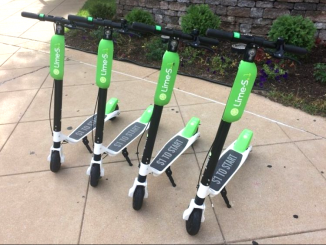 Lime and other companies leave their scooters on sidewalks and other public places, hoping somebody will want to grab one and pay the fee to take a ride. File photo.