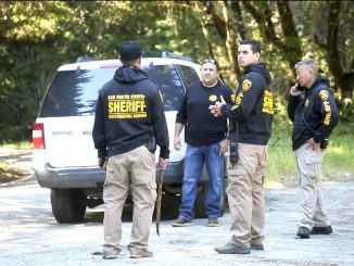 San Mateo County sheriff's officers investigate two homicides on Skyline Boulevard. Photo by Karl Mondon, Bay Area News Group, via AP.
