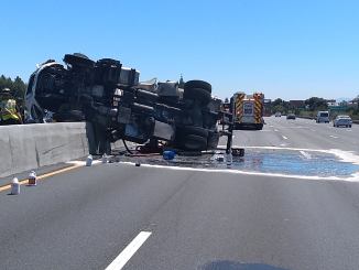 This truck carrying human waste from Porta Potties crashed yesterday on Highway 101 in Palo Alto near the San Antonio Road off-ramp. CHP photo.