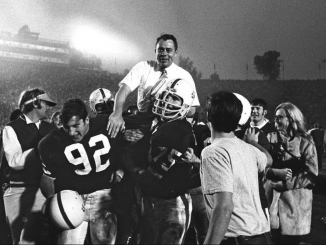 In this In this Jan. 1, 1971, file photo, Stanford coach John Ralston is carried off the field by his players after they defeated the Ohio State Buckeyes in the Rose Bowl game in Pasadena. AP photo.