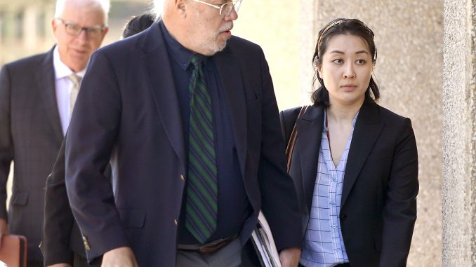Tiffany Li, right, and her attorney, Geoff Carr, arrive at the San Mateo County Government Center in Redwood City on Sept. 12. AP file photo.