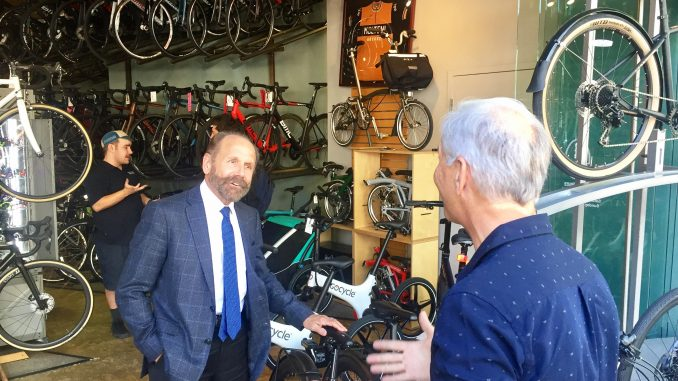 At left, State Sen. Jerry Hill, a San Mateo Democrat who represents the mid-Peninsula, visited Palo Alto Bicycles on University Avenue in this May 11, 2018 Post file photo.
