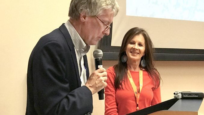 Palo Alto Mayor Eric Filseth delivers the opening remarks at the 22nd United Nations Association Film Festival at the Mitchell Park Community Center as festival founder Jasmina Bojic stands at his side. Post photo by Sara Tabin.
