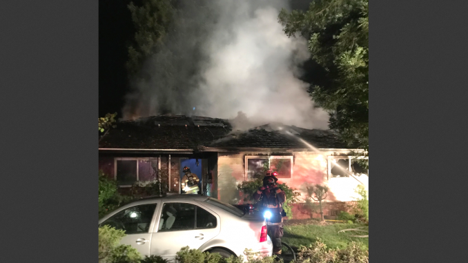 Firefighters pour water on a house on Hawthorne Avenue in Los Altos. Photo courtesy of the Santa Clara County Fire Department.