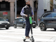 A man on an e-scooter buzzes along Market Street in San Francisco in this 2018 AP file photo.