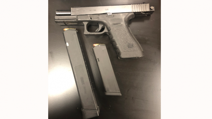 San Mateo police recovered this 9mm Glock handgun and these two high-capacity magazines from the Jeep belonging to a shooting suspect.