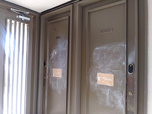 A vandal spray painted these doors at the University AME Zion Church in Palo Alto on Dec. 28. Post photo.